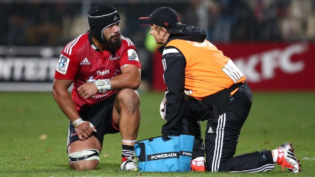 Jordan Taufua of the Crusaders is checked by team doctor Deb Robinson after a head knock last year.